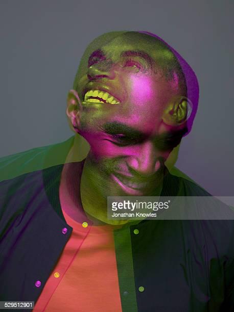 Multiple exposure, dark skinned male laughing