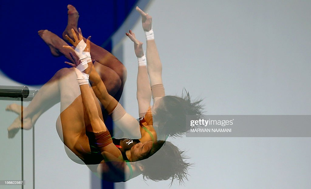 A multiple exposure image shows Chinese Shengping Wu of China as she performs in women's 10m platform at the 9th Asian Swimming Championships in Dubai, on November 22, 2012. Shenping won the gold medal in the event. AFP PHOTO/MARWAN NAAMANI