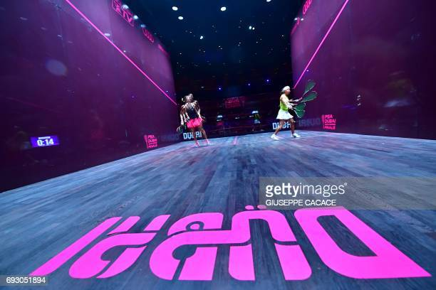 A multiple exposure image shows Nicol David of Malaysia competing against Laura Massaro of England during the first day of the PSA Dubai World Series...