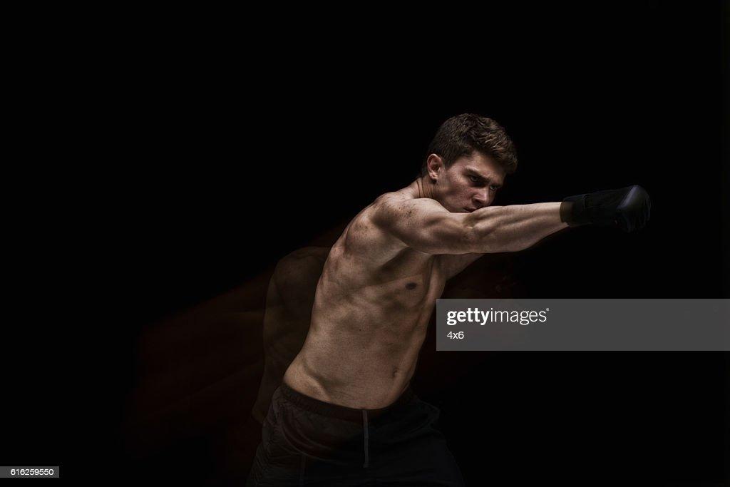 Exposición múltiple-Muscular man lucha : Foto de stock