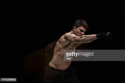 Multiple Exposure - Muscular man fighting : Stock Photo