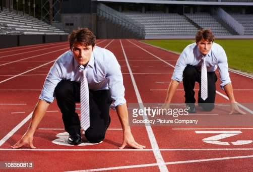 Multiple exposure of a business man getting ready for race : Stock Photo