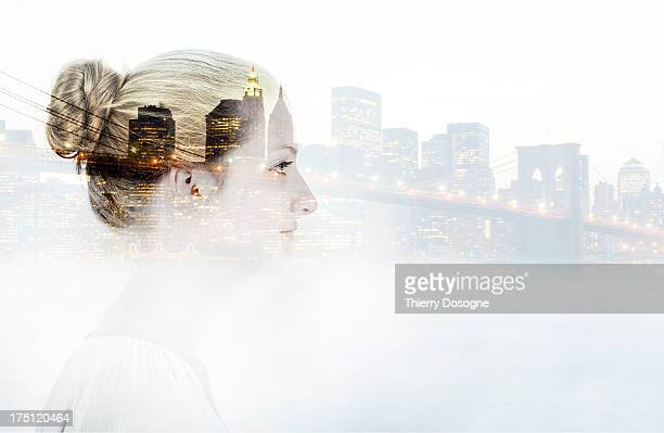 Multiple exposure of a woman and New York city by