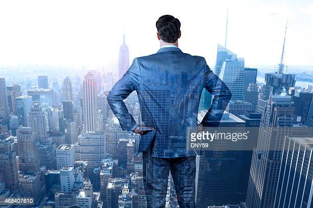Multiple Exposure Of Businessman Looking Out At New York City