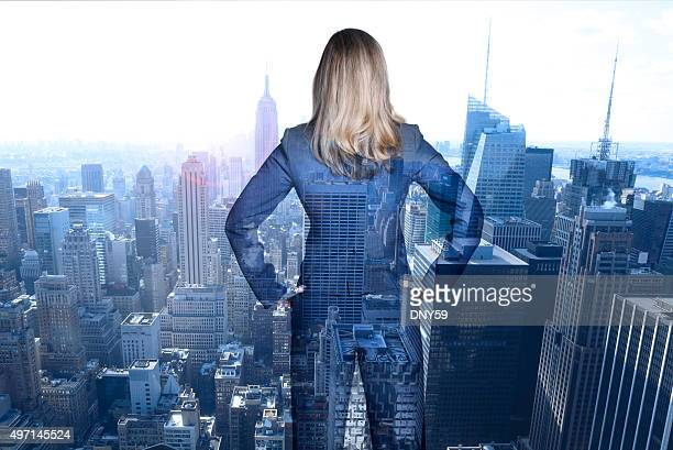 Multiple Exposure Of Businesswoman Looking Out At New York City
