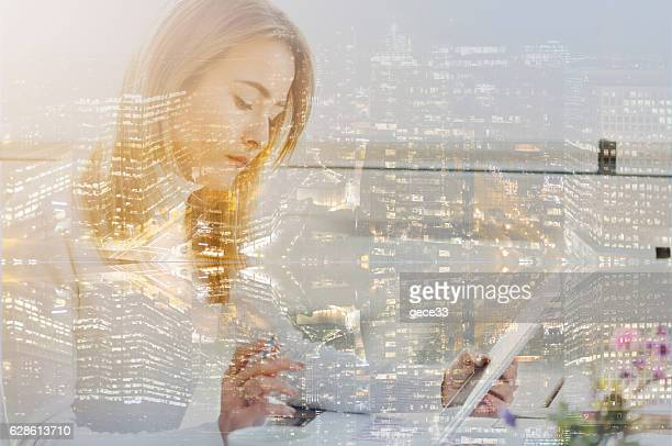 Multiple exposure of city and financial woman