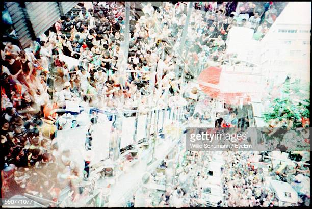 Multiple Exposure Of Crowd Gathered Outdoors