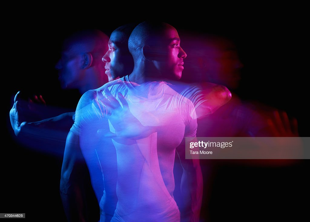 multiple exposure of man exercising : Stock Photo