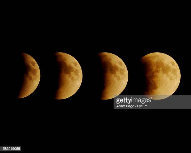 Multiple Exposure Of Moon Eclipse Against Black Background