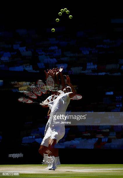 A multiple exposure of Roger Federer as he serves during his match with Marin Cilic on Centre Court during day nine of the 2016 Wimbledon tennis...