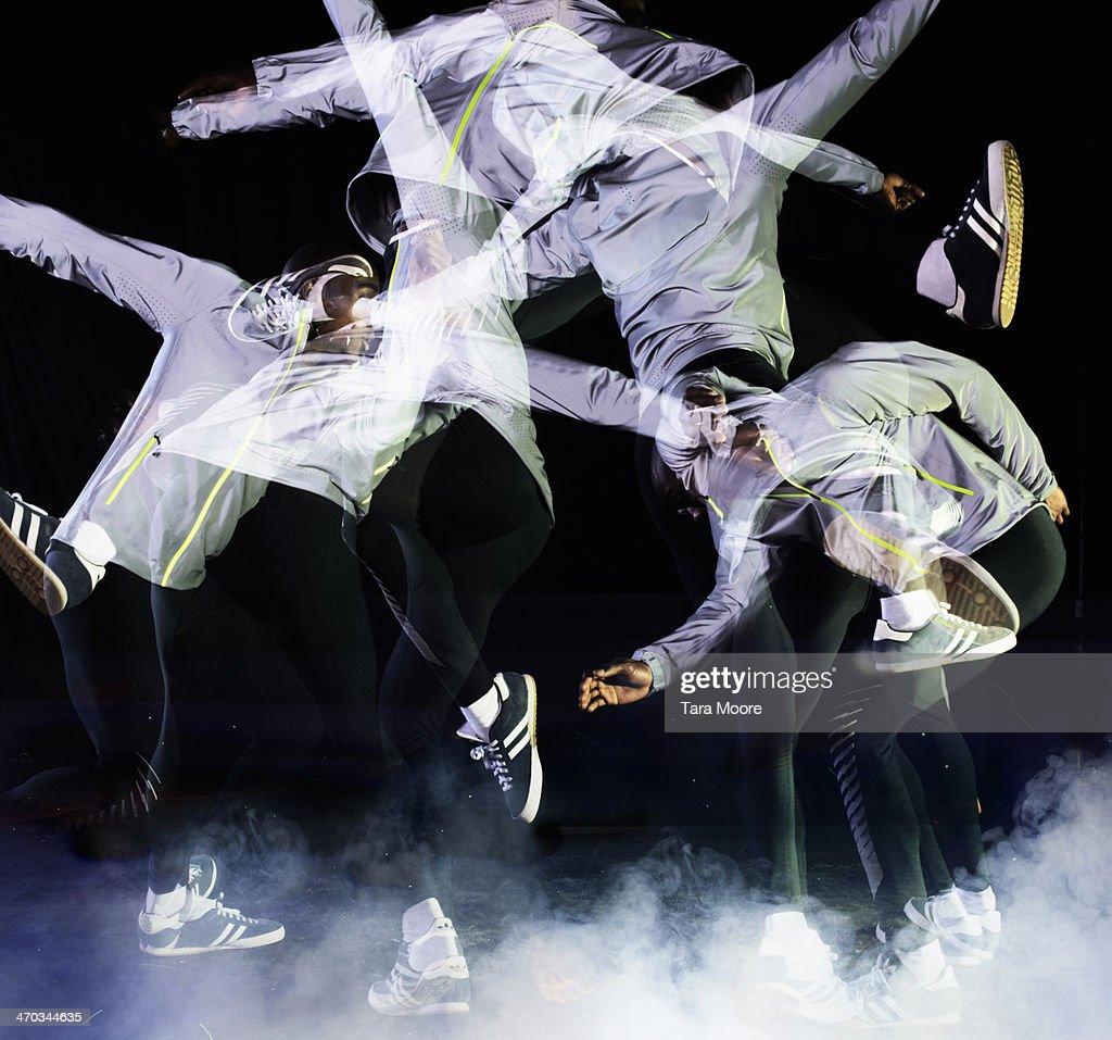 multiple exposure of urban man jumping