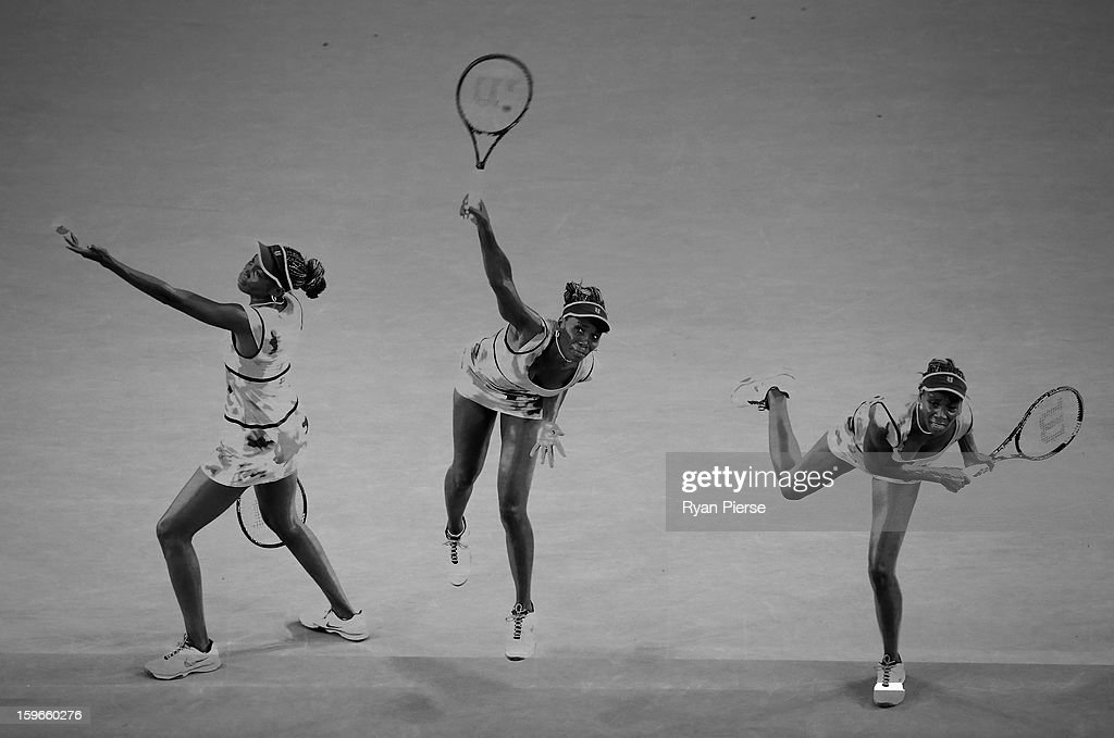 A multiple exposure of <a gi-track='captionPersonalityLinkClicked' href=/galleries/search?phrase=Venus+Williams&family=editorial&specificpeople=171981 ng-click='$event.stopPropagation()'>Venus Williams</a> of the United States serving during her third round match against Maria Sharapova of Russia during day five of the 2013 Australian Open at Melbourne Park on January 18, 2013 in Melbourne, Australia.