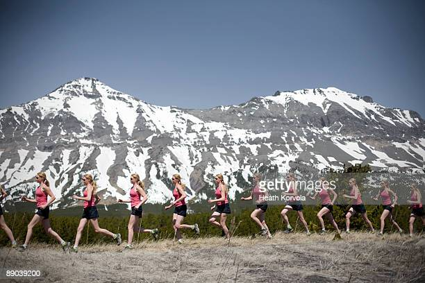 Multiple exposure of woman running in mountains.