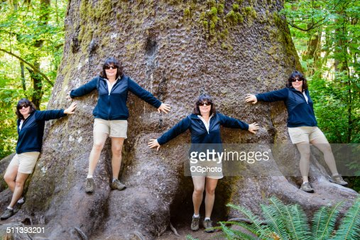 Multiple exposure of woman standing around a giant tree. -XXXL : Stock Photo