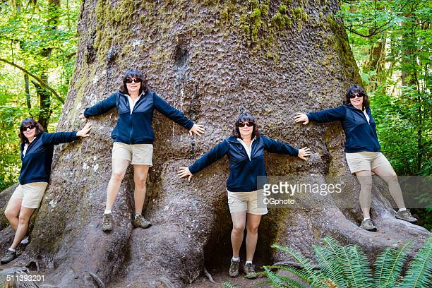 Multiple exposure of woman standing around a giant tree. -XXXL