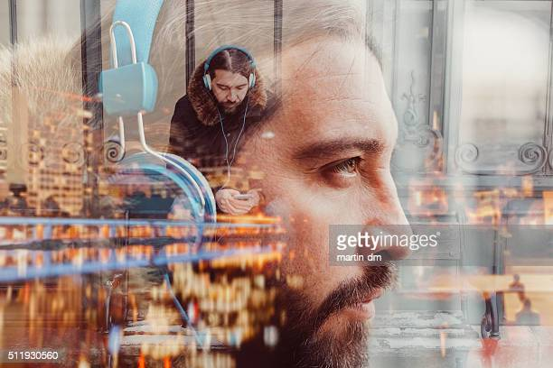 Multiple exposure photo of man with headphones
