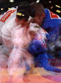 A multiple exposure picture shows Brazil's Tiago Camilo competing with Ukraine's Roman Gontiuk during their men's 90kg judo contest match of the...