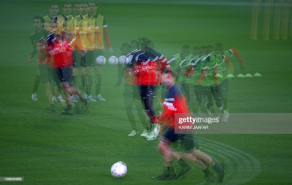 A multiple exposure picture shows Paris Saint-Germain (PSG) football players attending a training session at the Aspire Academy of Sports Excellence in the Qatari capital Doha on December 31, 2012. PSG is in Qatar for a week-long training camp before the resumption of the French Ligue 1 after the winter break.