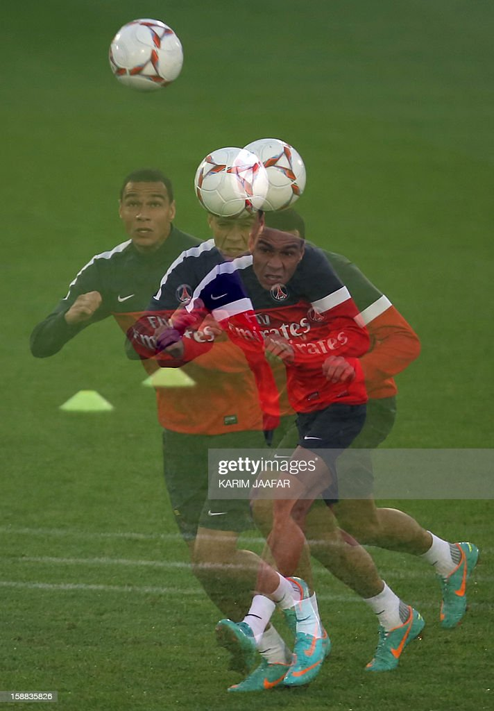 A multiple exposure picture shows Paris Saint-Germain's defender Gregory Van Der Wiel, attending a training session at the Aspire Academy of Sports Excellence in the Qatari capital Doha on December 31, 2012. PSG is in Qatar for a week-long training camp before the resumption of the French Ligue 1 after the winter break.