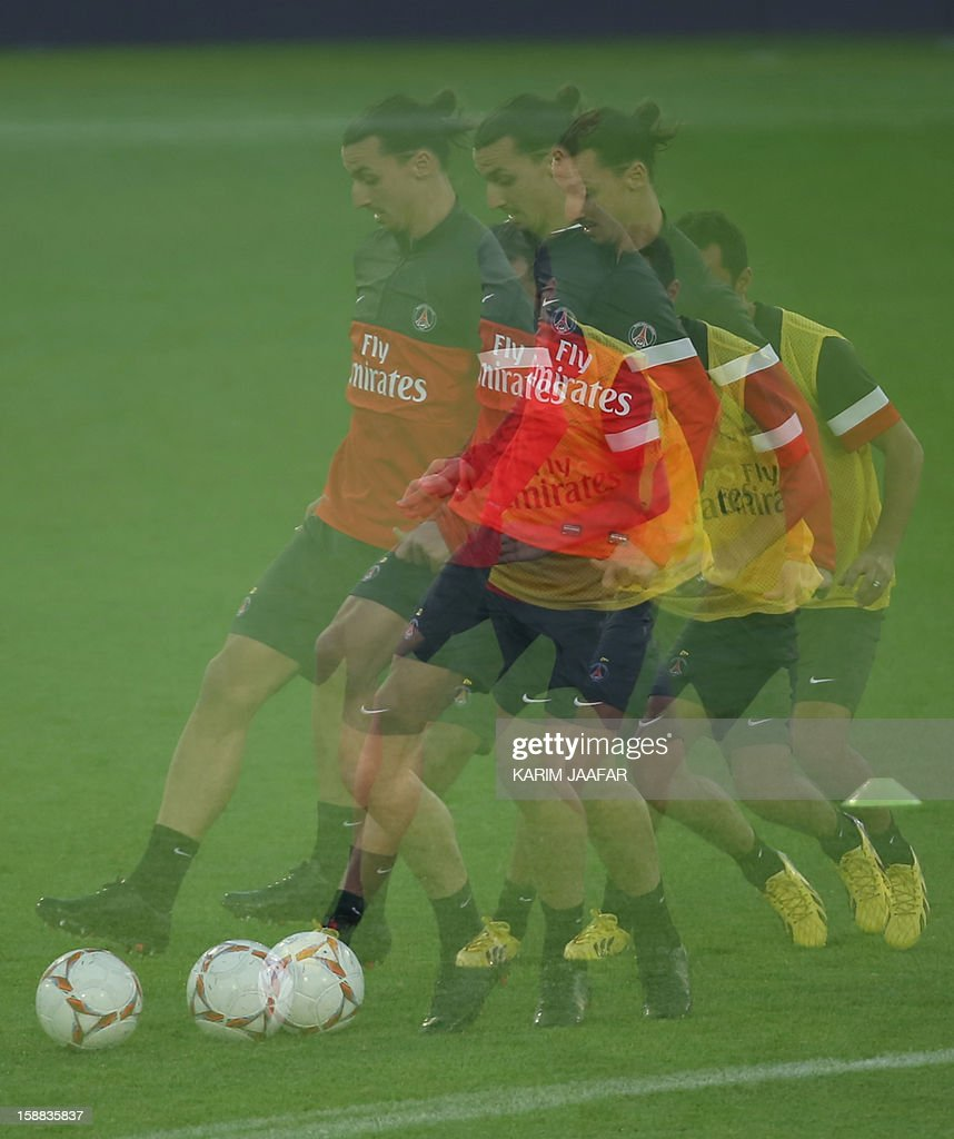 A multiple exposure picture shows Paris Saint-Germain's (PSG) forward Zlatan Ibrahimovic attending a training session at the Aspire Academy of Sports Excellence in the Qatari capital Doha on December 31, 2012. PSG is in Qatar for a week-long training camp before the resumption of the French Ligue 1 after the winter break.