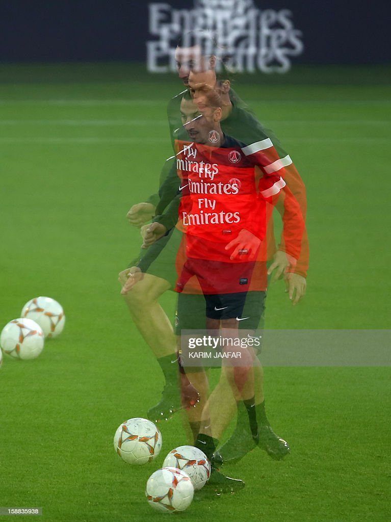 A multiple exposure picture shows Paris Saint-Germain's (PSG) forward Zlatan Ibrahimovic attending a football training session at the Aspire Academy of Sports Excellence in the Qatari capital Doha on December 31, 2012. PSG is in Qatar for a week-long training camp before the resumption of the French Ligue 1 after the winter break.