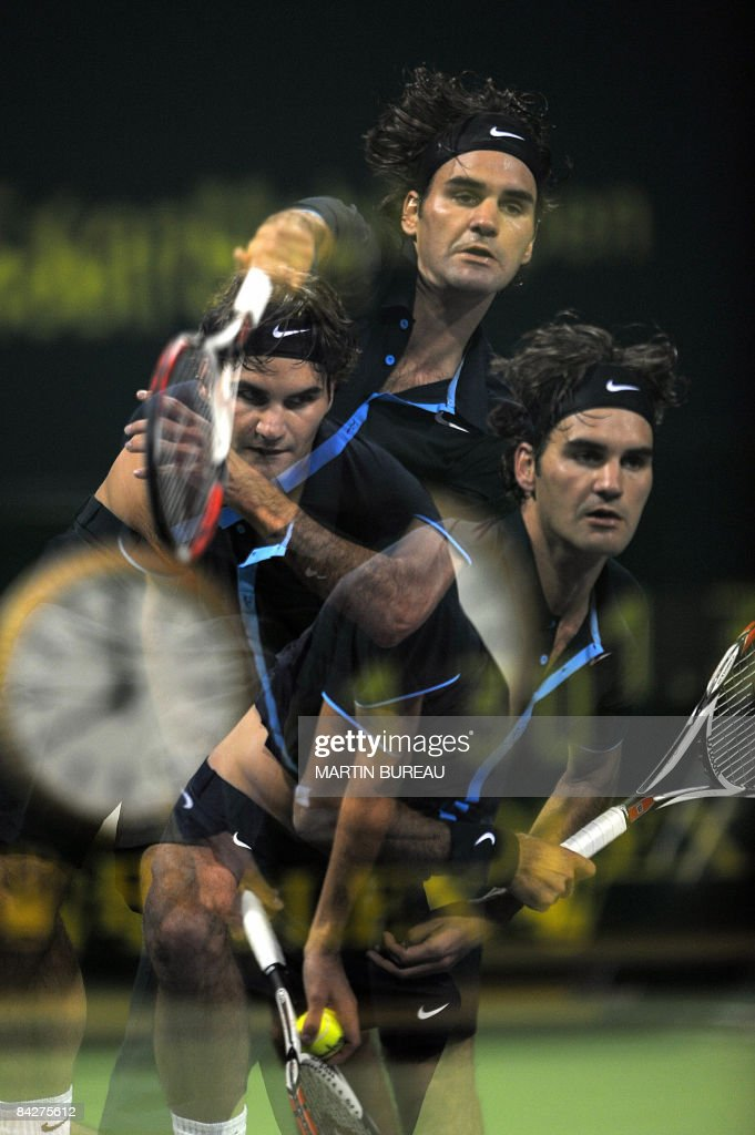 A multiple exposure picture shows Swiss tennis player Roger Federer serving to Britain's Andy Murray during their semifinal match in the Qatar Open...