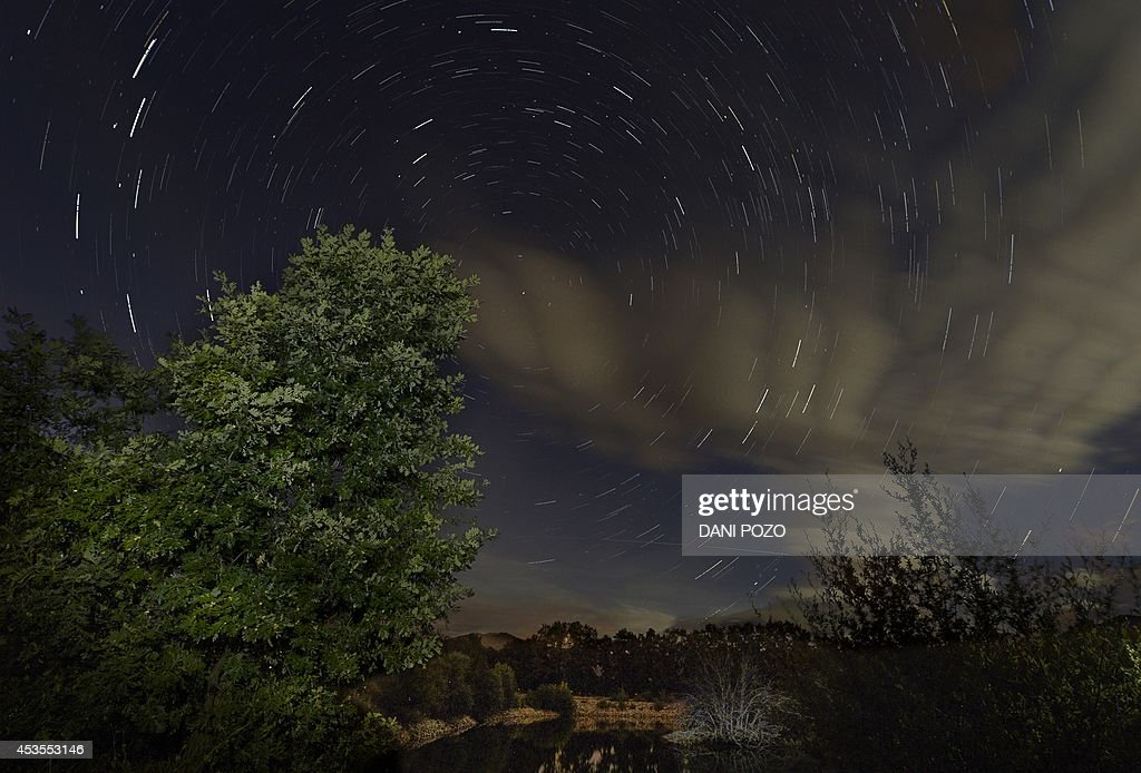 A multiple exposure picture taken in the early hours of August 12, 2014 shows a Perseids meteor shower in the night sky from the mountains of the Sierra Norte de Madrid near the municipality of Valle del Lozoya. The perseid meteor shower occurs every year in August when the Earth passes through the debris and dust of the Swift-Tuttle comet.