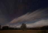 A multiple exposure picture taken in the early hours of August 12 2014 shows a Perseids meteor shower in the night sky from the mountains of the...