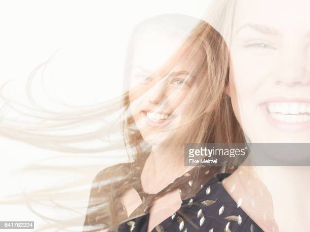 multiple exposure portrait of young woman laughing