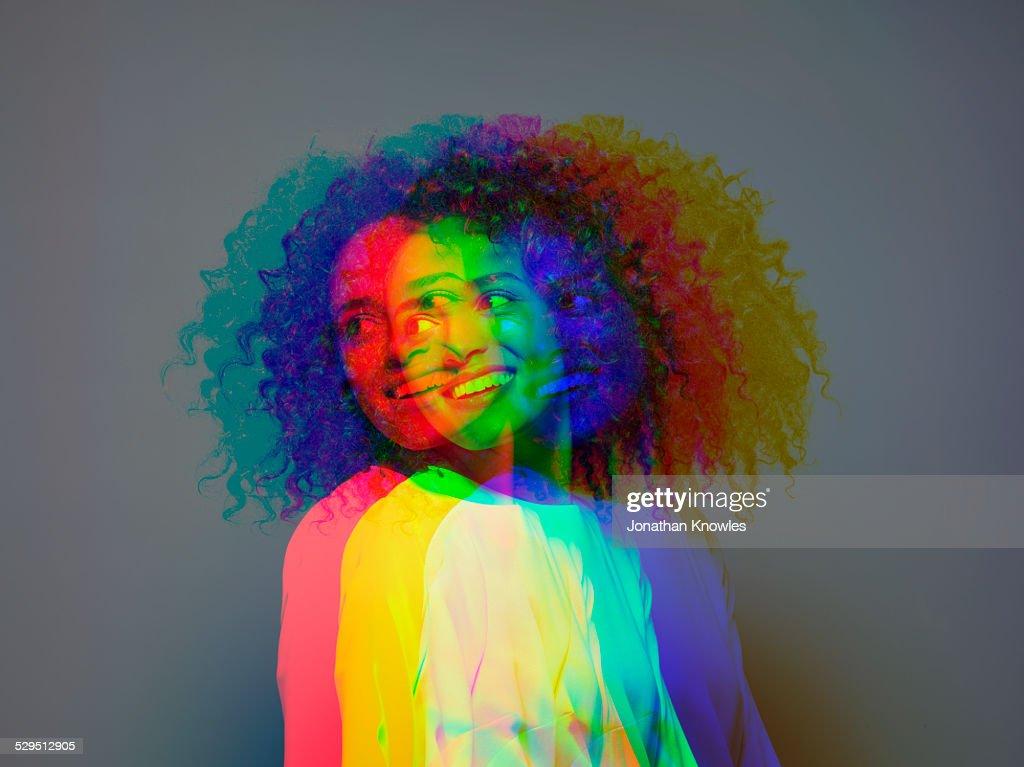 Multiple exposure,dark skinned female smiling