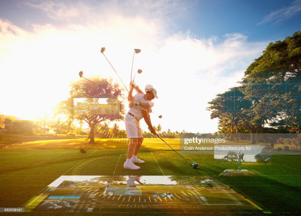 Multiple exposures of Caucasian golfer hitting ball on course surrounded by holograms
