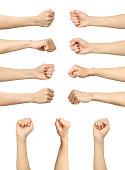 Multiple female caucasian clenched fist isolated over white background