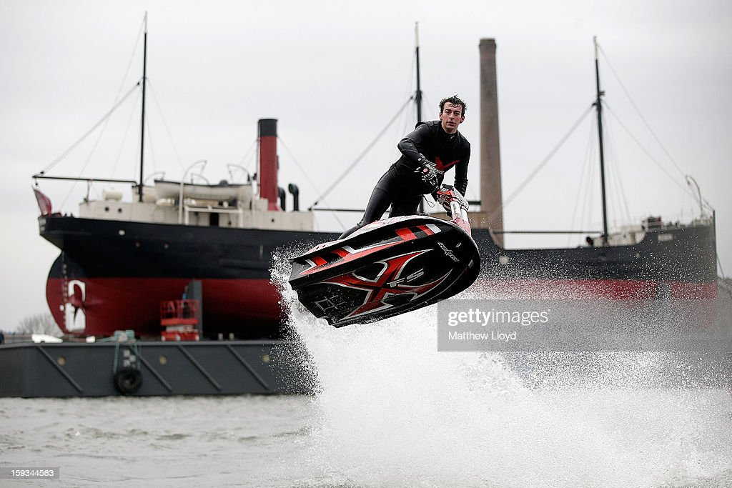 Multiple freestyle Jet Ski champion Jack Moule performs stunts in the marina at the 2013 London Boat Show, held at the eXcel centre, on January 12, 2013 in London, England. Until the 20th of January the London Boat Show will showcase, demonstrate and sell maritime equipment ranging from luxury yachts to dinghies.