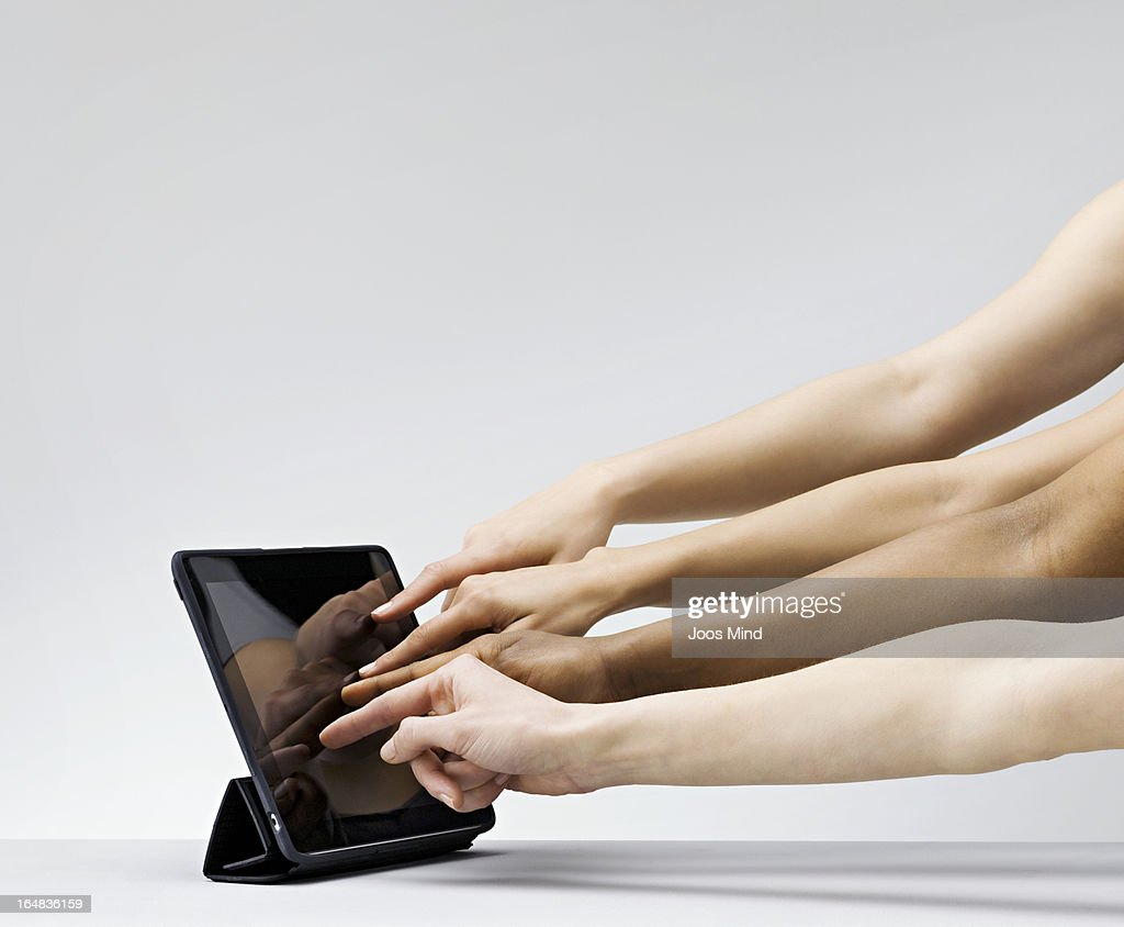 Multiple hands with fingers on table screen