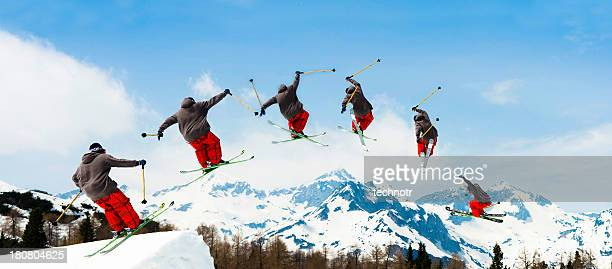 Multiple Image of Free Style Skier Jumping Over the Hill