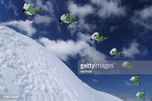 Multiple image of snowboarder in mid air