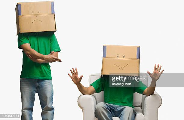 Multiple images of a man covering his face in cardboard boxes