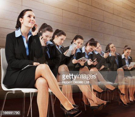 Multiple images of seated businesswoman
