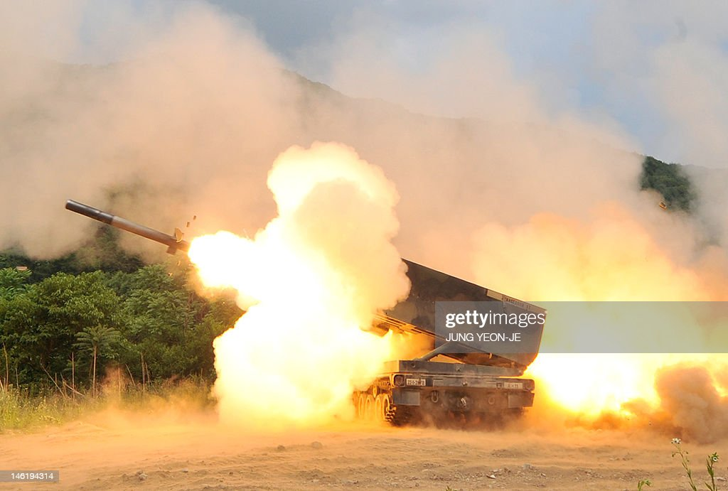 US Multiple Launch Rocket System launches a rocket into the air during a live fire training exercise in the South Korean border county of Cheorwon on...