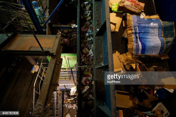 Multiple layers of conveyer belts transport sorted and unsorted materials during the recyclables recovery process at the Materials Recovery Facility...