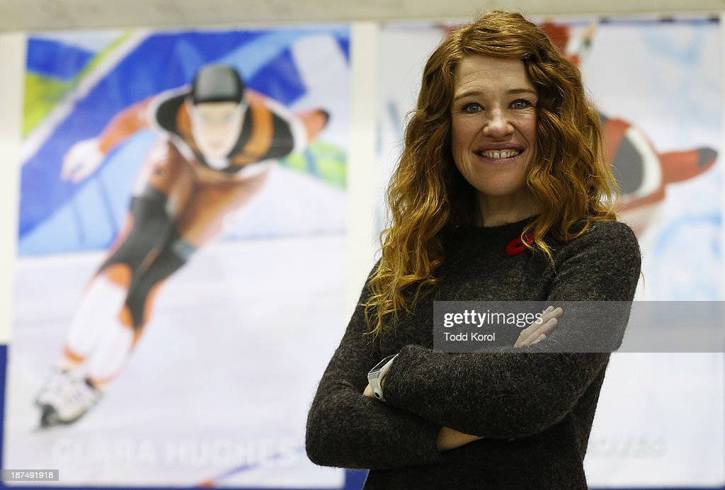 Multiple medalist in cycling and speed skating, olympian Clara Hughs poses for a photograph after being inducted into the Olympic Oval wall of fame during the ISU World Cup Speed Skating event November 9, 2013 in Calgary, Alberta, Canada.