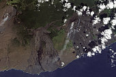 December 11, 2009 - Multiple plumes blow toward the south-southwest from Kilauea. One of Hawaii�s most active volcanoes, Kilauea is a shield volcano with a low, broad shape resembling an ancient warr