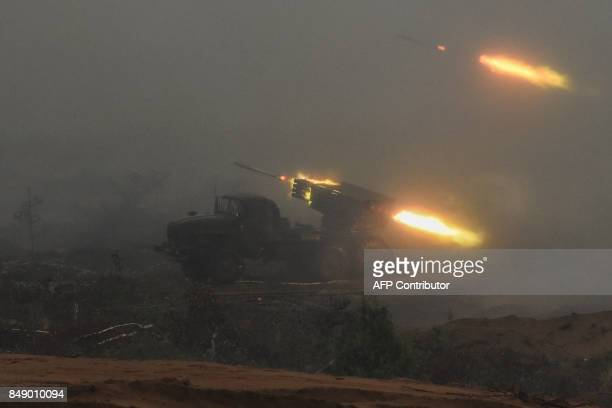 A multiple rocket launch system fires during the joint RussianBelarusian military exercises Zapad2017 at the Luzhsky training ground in the Leningrad...