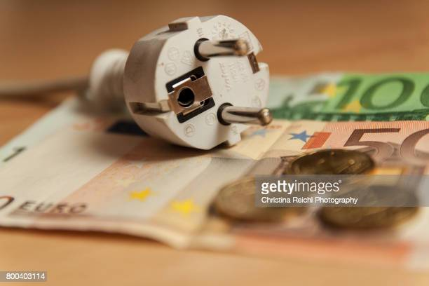 Multiple socket and Euro banknotes on white background, close-up