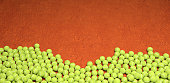 Multiple tennis balls background on clay