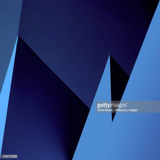 Multiple triangles in varying tones of blue
