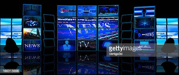 Multiple TV screens display news in a dark studio