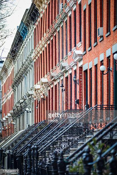 Multiple Urban Brick Townhouses Looking Down Street Diminishing In Perspective