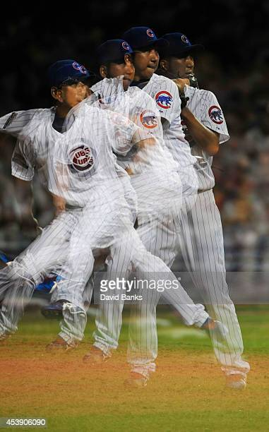 A multipleexposure sequence of Kyuji Fujikawa of the Chicago Cubs pitching against the San Francisco Giants during the eighth inning on August 20...