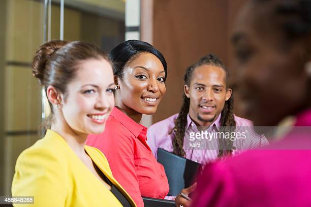 Multi-racial business people, focus on black woman